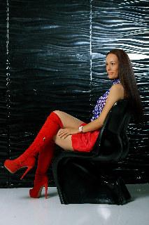 Red overknee boots on high heels, red mini skirt